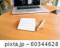 Blank business cards and laptop on wooden surface 60344628