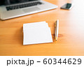 Blank business cards and laptop on wooden surface 60344629
