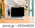 Laptop on wooden table with clipping path 60344630
