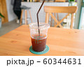 Ice americano coffee on wooden table 60344631