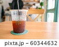 Ice americano coffee on wooden table 60344632