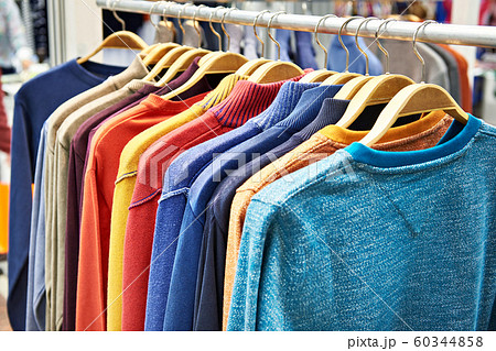 Sweaters on hanger in store 60344858