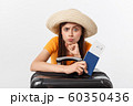 Lifestyle and travel Concept: Young beautiful caucasian woman is sitting on suitecase and waiting for her flight.Isolated over white background 60350436