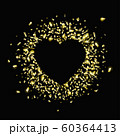 Gold pieces of foil in the shape of a heart 60364413