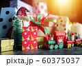 Santa Claus doll, gift box present and christmas ornament for christmas greeting seasonal background. selective focus 60375037