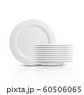 A pile and stack of clean white dishes and plates for serving food. 60506065