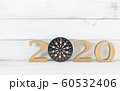Upcoming 2020 New Year with Dartboard over white 60532406