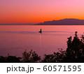 赤穂御崎の沖合にある小さな灯標と夕暮れ慕情(背景:小豆島、家島諸島) 60571595