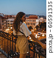 Beautiful caucasian woman smiling. On the streets of old town in Cannes, France. 60591335