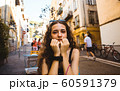 Beautiful caucasian woman smiling. On the streets of old town in Nice, France. 60591379