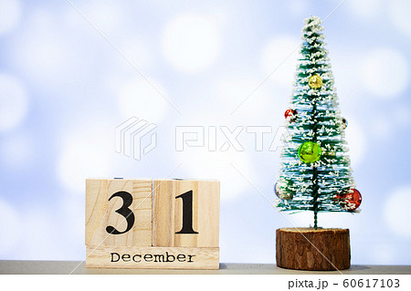 31 december and christmas decoration on blue background 60617103