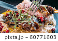 Close-up of slicing the appetizing roasted duck with fork and knife 60771603