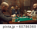 Poker players at gaming table with bets, casino 60786360