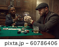 Poker player puts his wristwatch on the bank 60786406