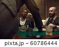 Three poker players in casino, blackjack 60786444