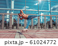 Man dancer, muscle jump in flight, dancing breakdance, summer in city, free space for text, hip-hop break dancer. Youth lifestyle, active, trend modern, fitness sport, positive motivation. 61024772