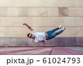 Superman flight, man acrobat dancer, handstand, dancing breakdance, summer city, free space text, hip hop dancer. Youth lifestyle, active, trend modern, fitness sport, positive motivation. 61024793