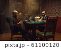 Poker players with cards and chips in casino 61100120