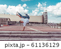 Male dancer dancing in summer city, break dance, fashionable and modern hip-hop dance style. Street lifestyle. Free space for copy text 61136129