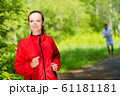 healthy young female athlete running 61181181