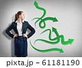 Businesswoman thinking something over 61181190