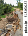 Collapse of the paved road in the forest 61303082