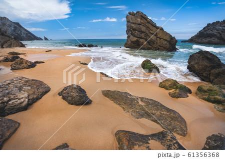 Rock on the Adraga beach -praia da Adraga Sintra, Portugal 61356368