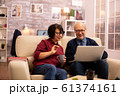 Elderly old couple using modern laptop to chat with their grandson 61374161