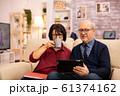 Beautiful old couple using a digital tablet to chat with their family 61374162