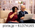 Grandmother and grandfather using a laptop to chat with their grandsons 61374165