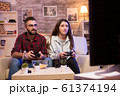 Couple enjoying their time together while playing video games 61374194