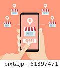 Hand holding smartphone with shop on the screen. Order food and drink concept. 61397471