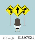 Businesswoman standing on three way arrows road sign. 61397521