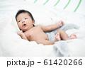 Newborn infant baby boy lying on a white blanket. 61420266