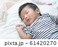 Adorable Asian sleeping, tiny infant healthy sleep with warm wool white blanket at home. 61420270