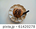 Homemade chocolate chip muffins on plates and fork. 61420278
