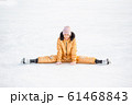 Little adorable girl sitting on ice with skates after fall 61468843
