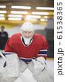 Determined Hockey Player 61538365
