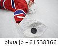 Hockey Player Lying on Ice 61538366