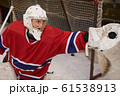 Female Hockey Player Defending Gate 61538913