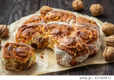 Homemade cinnamon and walnut swirl buns. 61568972