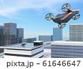 屋上にあるドローンポートに着陸態勢に入った大型旅客ドローン。空飛ぶタクシーのコンセプト 61646647