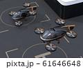 ドローンポートから離着陸する大型旅客ドローンのイメージ。空飛ぶタクシーのコンセプト 61646648