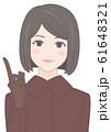 指さす女性 ボブスタイル コート 61648321