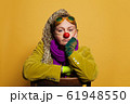 Mid adult woman actress  in clown costume 61948550