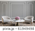 Classic gray interior with armchairs, coffee table, flowers and wall moldings. 61949498