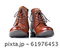 Pair of brown leather womens boots on the white 61976453