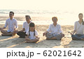 Holiday concept. A large family practicing yoga 62021642