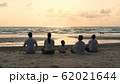 Holiday concept. A large family practicing yoga 62021644