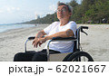Holiday concepts. Disabled old man looking at 62021667